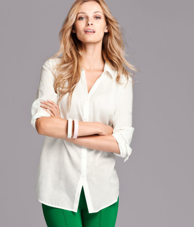 Blouse - neckline: shirt collar/peter pan/zip with opening; pattern: plain; length: below the bottom; style: shirt; shoulder detail: tiers/frills/ruffles; bust detail: buttons at bust (in middle at breastbone)/zip detail at bust; predominant colour: white; occasions: casual, work; trends: masculine tailoring; fibres: cotton - 100%; fit: straight cut; sleeve length: long sleeve; sleeve style: standard; pattern type: fabric; pattern size: standard