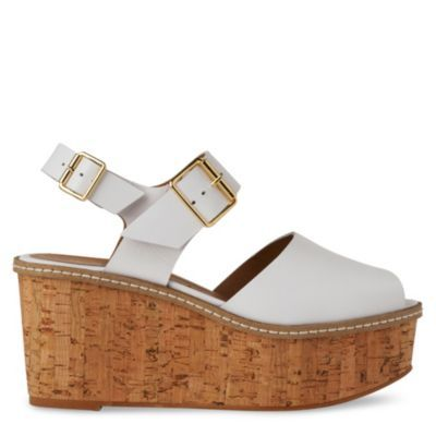 Penelope Buckle Wedge Sandals - predominant colour: white; material: suede; heel height: high; embellishment: buckles; ankle detail: ankle strap; heel: wedge; toe: open toe/peeptoe; style: standard