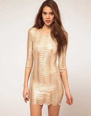 Dress In Scalloped Sequin - style: shift; length: mid thigh; neckline: round neck; pattern: metallic; hip detail: fitted at hip; predominant colour: gold; occasions: evening, occasion; fit: body skimming; fibres: polyester/polyamide - mix; material texture: metallic; sleeve length: 3/4 length; sleeve style: standard; pattern type: fabric; pattern size: standard