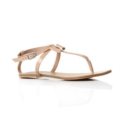 Nude Peyton Flip Flops & Sandals - predominant colour: nude; material: leather; heel height: flat; embellishment: buckles, ribbon; ankle detail: ankle strap; heel: standard; toe: open toe/peeptoe; style: flip flops / toe post
