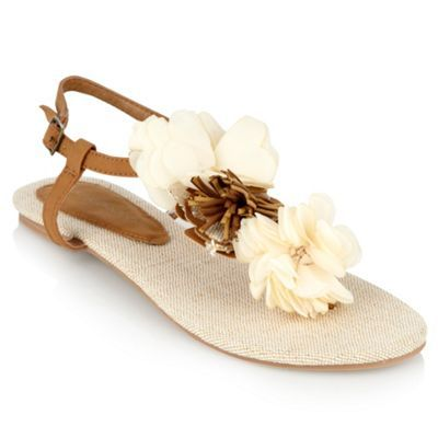 Natural Woven Corsage Flip Flops - predominant colour: tan; material: faux leather; heel height: flat; embellishment: buckles; ankle detail: ankle strap; heel: standard; toe: toe thongs; style: flip flops / toe post
