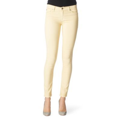 Sorbet Skinny Jeans - style: skinny leg; pattern: plain; pocket detail: traditional 5 pocket; waist: mid/regular rise; predominant colour: primrose yellow; occasions: casual; length: ankle length; fibres: cotton - mix; material texture: denim; trends: pastels; texture group: denim; pattern type: fabric; pattern size: standard