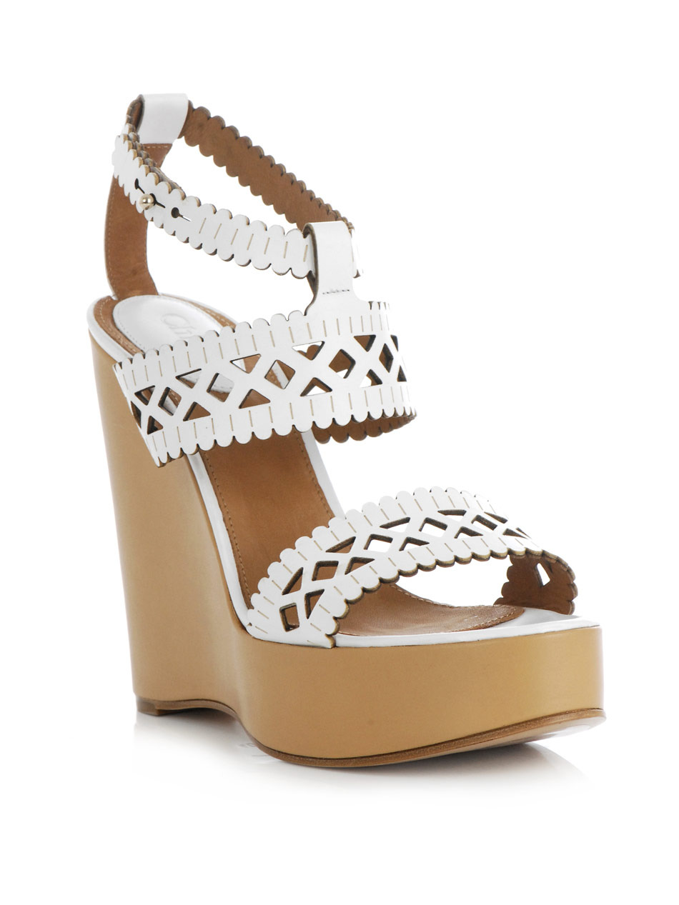 Laser Cut Leather Wedge Shoes - predominant colour: white; material: leather; heel height: high; embellishment: embroidered; ankle detail: ankle strap; heel: wedge; toe: open toe/peeptoe; style: strappy