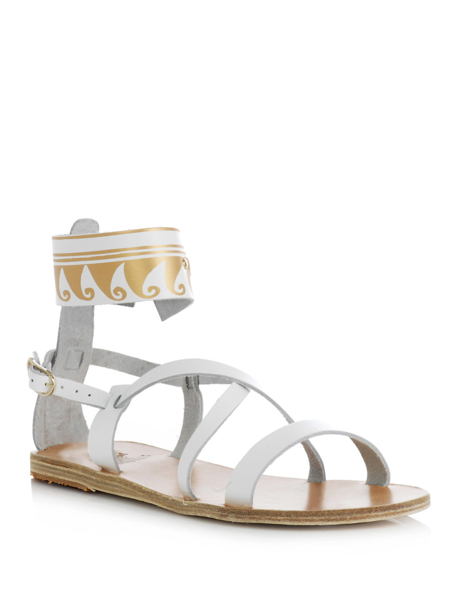 Nausicaa Gladiator Sandals - predominant colour: white; material: leather; heel height: flat; embellishment: print; ankle detail: ankle strap; heel: standard; toe: open toe/peeptoe; style: strappy; pattern: patterned/print