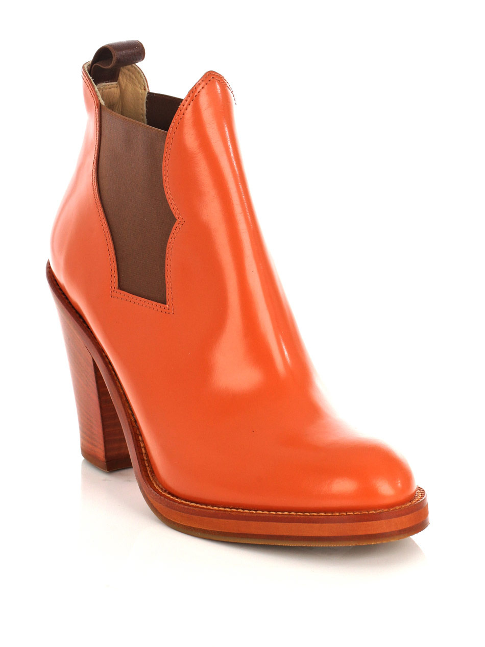 Star Ankle Boots - predominant colour: bright orange; material: leather; heel height: high; embellishment: elasticated; heel: block; toe: round toe; boot length: ankle boot; style: riding
