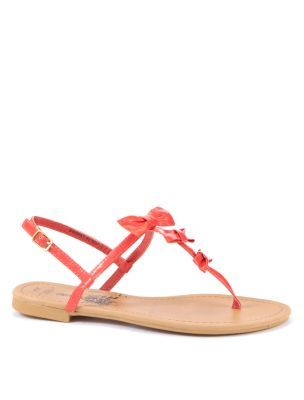 Coral Patent Bow Sandals - predominant colour: coral; material: patent; heel height: flat; embellishment: buckles; ankle detail: ankle strap; heel: block; toe: toe thongs; style: flip flops / toe post; finish: patent