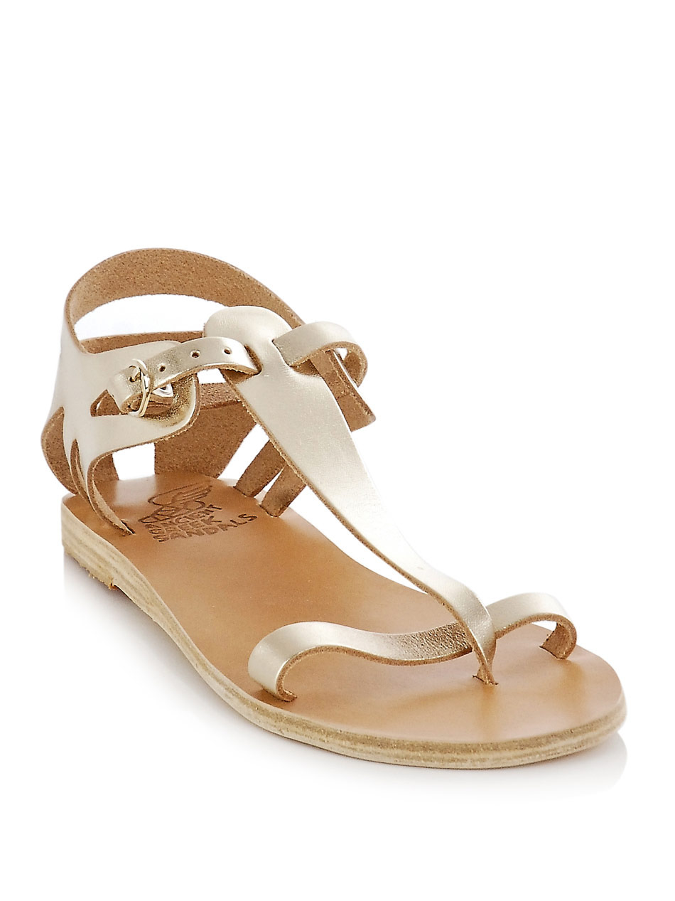 Ariadne Cut Out Sandals - predominant colour: gold; material: leather; heel height: flat; ankle detail: ankle strap; heel: standard; toe: toe thongs; style: gladiators