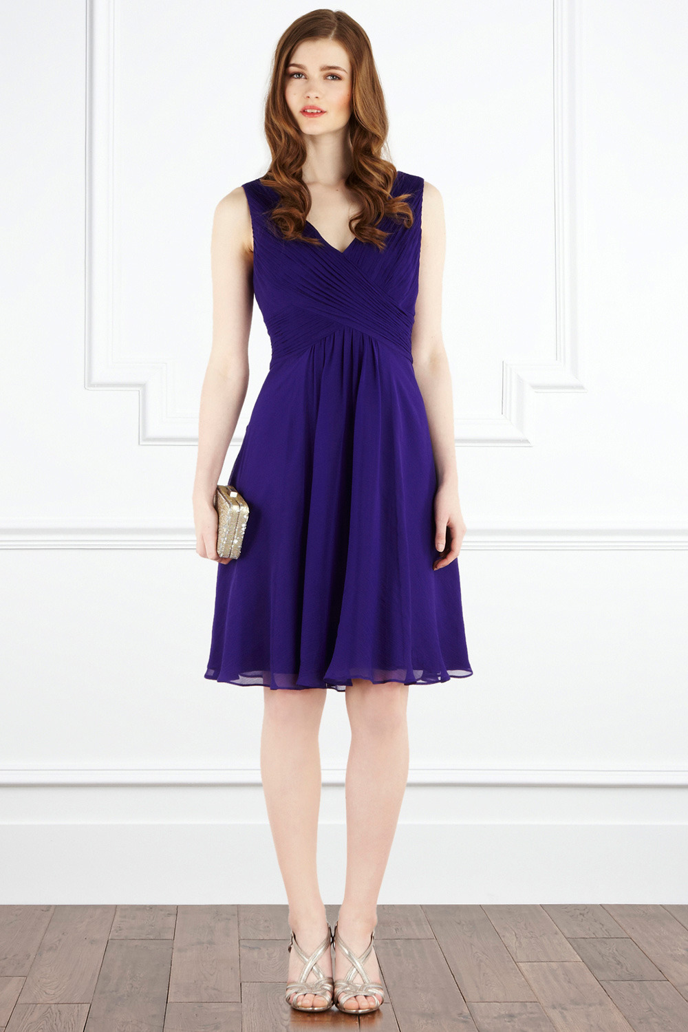 Almondo Dress - style: shift; neckline: v-neck; pattern: plain; sleeve style: sleeveless; waist detail: fitted waist; back detail: low cut/open back; bust detail: ruching/gathering/draping/layers/pintuck pleats at bust; predominant colour: purple; occasions: evening, occasion; length: on the knee; fit: body skimming; fibres: silk - 100%; material texture: chiffon; hip detail: ruching/gathering at hip, soft pleats at hip/draping at hip/flared at hip; trends: aquatic; sleeve length: sleeveless; texture group: sheer fabrics/chiffon/organza etc.; pattern type: fabric; pattern size: standard