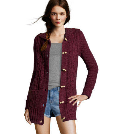 Cardigan - neckline: v-neck; style: chunky knit; back detail: hood; hip detail: front pockets at hip; pattern: cable knit; predominant colour: burgundy; occasions: casual; fibres: acrylic - mix; material texture: jersey; fit: standard fit; length: mid thigh; sleeve length: long sleeve; sleeve style: standard; pattern type: knitted - other; pattern size: standard; texture group: jersey - stretchy/drapey