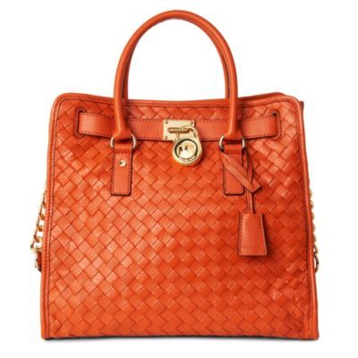 Hamilton Woven Large Tote - predominant colour: bright orange; type of pattern: standard; style: tote; length: shoulder (tucks under arm); size: standard; material: leather; embellishment: quilted, studs, tassels; pattern: monogram, plain