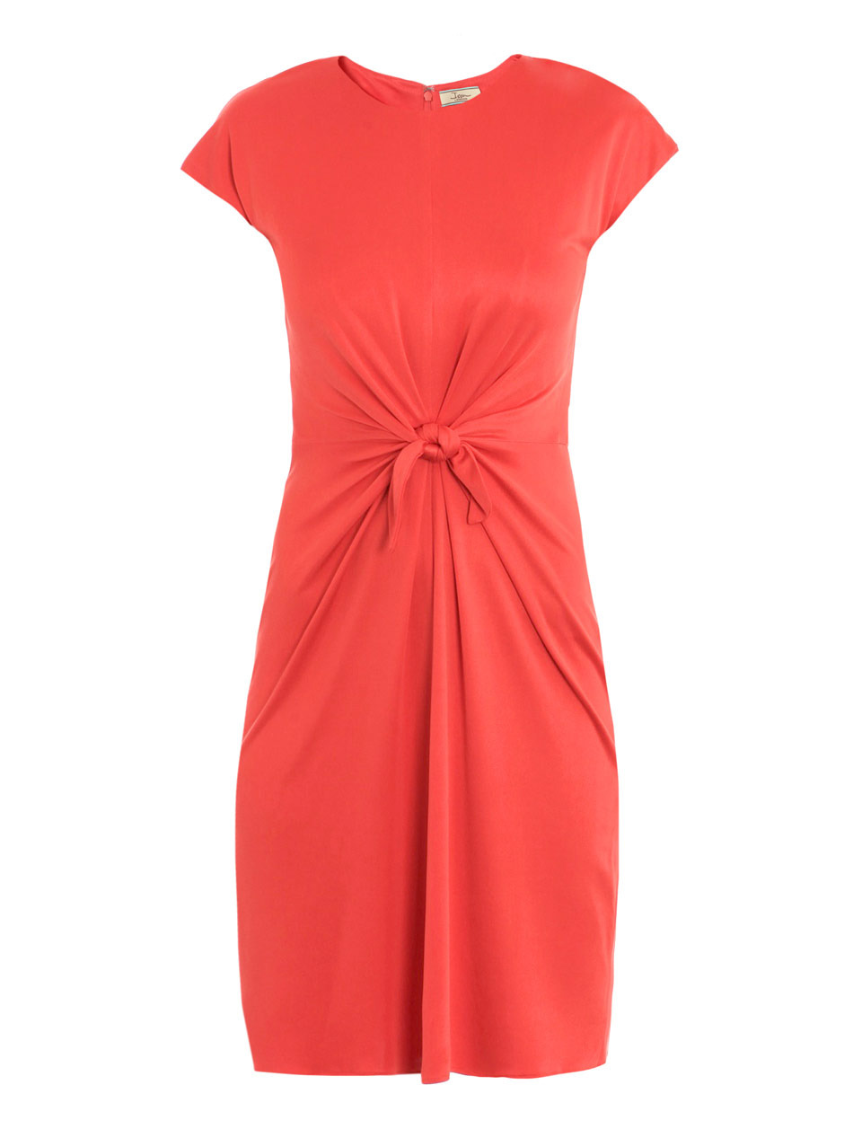 Knotted Front Dress - style: shift; neckline: round neck; sleeve style: capped; pattern: plain; waist detail: fitted waist, twist front waist detail/nipped in at waist on one side/soft pleats/draping/ruching/gathering waist detail, belted waist/belt detail/tie at waist; predominant colour: coral; occasions: casual wear, evening wear; length: just above the knee; fit: body skimming; material: pure silk; material texture: jersey; hip detail: soft pleats at hip/draping at hip; trends: pastels, brights; sleeve length: short sleeve