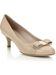 Carla 55mm Patent Pump - predominant colour: stone; occasions: evening, work, occasion; material: leather; heel height: mid; heel: kitten; toe: round toe; style: courts; finish: patent; pattern: plain; embellishment: bow