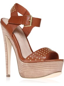 Martini - predominant colour: tan; occasions: casual, evening, occasion, holiday; material: leather; heel height: high; embellishment: studs; ankle detail: ankle strap; heel: platform; toe: open toe/peeptoe; style: standard; finish: plain; pattern: plain
