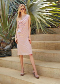 Knitted Dress - style: shift; neckline: cowl/draped neck; pattern: plain; sleeve style: sleeveless; predominant colour: nude; occasions: evening, occasion; length: on the knee; fit: body skimming; fibres: silk - 100%; sleeve length: sleeveless; texture group: jersey - stretchy/drapey