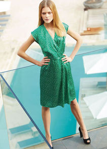 Silk Dress - style: faux wrap/wrap; neckline: low v-neck; sleeve style: capped; fit: fitted at waist; waist detail: fitted waist; pattern: polka dot; secondary colour: ivory; predominant colour: emerald green; occasions: evening; length: just above the knee; fibres: silk - 100%; hip detail: structured pleats at hip; sleeve length: sleeveless; texture group: silky - light; pattern type: fabric; pattern size: small &amp; busy