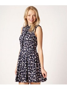 Dark Blue Floral Shirt Dress - length: mid thigh; neckline: shirt collar/peter pan/zip with opening; sleeve style: sleeveless; waist detail: twist front waist detail/nipped in at waist on one side/soft pleats/draping/ruching/gathering waist detail; bust detail: buttons at bust (in middle at breastbone)/zip detail at bust; secondary colour: ivory; predominant colour: navy; occasions: casual, evening, holiday; fit: fitted at waist & bust; style: fit & flare; fibres: cotton - 100%; hip detail: soft pleats at hip/draping at hip/flared at hip; sleeve length: sleeveless; texture group: cotton feel fabrics; trends: high impact florals; pattern type: fabric; pattern size: small & busy; pattern: florals