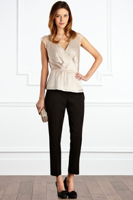 Traviata Top - neckline: low v-neck; sleeve style: capped; pattern: plain; style: wrap/faux wrap; shoulder detail: contrast pattern/fabric at shoulder; waist detail: peplum waist detail; bust detail: ruching/gathering/draping/layers/pintuck pleats at bust; predominant colour: champagne; occasions: evening, occasion; length: standard; fibres: silk - mix; fit: tailored/fitted; sleeve length: short sleeve; texture group: structured shiny - satin/tafetta/silk etc.; pattern type: fabric; pattern size: standard
