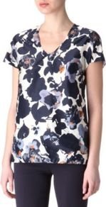 Floral Print Top - neckline: v-neck; secondary colour: white; predominant colour: navy; occasions: casual, evening, work; length: standard; style: top; fibres: silk - mix; fit: body skimming; sleeve length: short sleeve; sleeve style: standard; texture group: silky - light; trends: high impact florals; pattern type: fabric; pattern size: big &amp; busy; pattern: florals