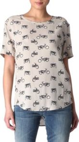 Riley Motorcycle Printed Top - style: t-shirt; predominant colour: stone; secondary colour: charcoal; occasions: casual; length: standard; fibres: silk - 100%; fit: body skimming; neckline: crew; back detail: longer hem at back than at front; sleeve length: short sleeve; sleeve style: standard; texture group: silky - light; pattern type: fabric; pattern size: small & busy; pattern: patterned/print