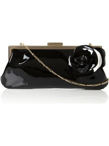 Black Patent Bex Large Flower Corsage Clutch Bag - predominant colour: black; occasions: evening, occasion; type of pattern: standard; style: clutch; length: hand carry; size: small; material: leather; pattern: plain; finish: patent; embellishment: corsage