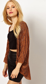 Embellished Shrug - pattern: plain; length: below the bottom; neckline: collarless open; bust detail: ruching/gathering/draping/layers/pintuck pleats at bust; style: open front; predominant colour: terracotta; secondary colour: bronze; occasions: casual, evening, work, holiday; fibres: polyester/polyamide - mix; fit: loose; shoulder detail: added shoulder detail; back detail: longer hem at back than at front; sleeve length: 3/4 length; sleeve style: standard; trends: metallics; pattern type: knitted - big stitch; pattern size: standard; texture group: jersey - stretchy/drapey; embellishment: beading