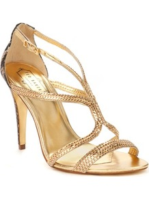 Ted Baker Tilbey Metal Chain Sandal - predominant colour: gold; occasions: evening, occasion, holiday; material: leather; heel height: high; ankle detail: ankle strap; heel: standard; toe: open toe/peeptoe; style: strappy; trends: metallics; finish: metallic; pattern: plain; embellishment: chain/metal