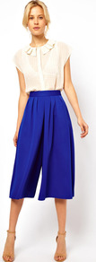 Culottes - pattern: plain; style: shorts; waist: high rise; length: below the knee; predominant colour: navy; occasions: evening, work; fibres: polyester/polyamide - 100%; hip detail: front pleats at hip level; waist detail: narrow waistband; fit: wide leg; pattern type: fabric; texture group: jersey - stretchy/drapey