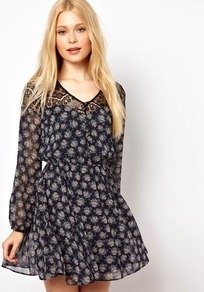 Skater Dress With Floral Print - length: mid thigh; neckline: v-neck; fit: fitted at waist; waist detail: fitted waist; predominant colour: navy; occasions: casual, evening; style: fit & flare; fibres: polyester/polyamide - 100%; sleeve length: long sleeve; sleeve style: standard; texture group: sheer fabrics/chiffon/organza etc.; pattern type: fabric; pattern size: small & busy; pattern: patterned/print