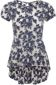 Navy Floral Silhouette Dip Hem Peplum T Shirt - length: below the bottom; waist detail: peplum waist detail; secondary colour: ivory; predominant colour: navy; occasions: casual; style: top; fibres: cotton - 100%; fit: body skimming; neckline: crew; back detail: longer hem at back than at front; sleeve length: short sleeve; sleeve style: standard; pattern type: fabric; pattern size: small & busy; pattern: florals; texture group: jersey - stretchy/drapey