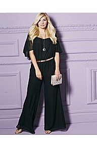 Petite Cape Sleeve Jumpsuit - sleeve style: dolman/batwing; fit: fitted at waist; pattern: plain; waist detail: belted waist/tie at waist/drawstring; length: extra long; predominant colour: black; occasions: evening, occasion, holiday; fibres: polyester/polyamide - 100%; hip detail: soft pleats at hip/draping at hip/flared at hip; sleeve length: short sleeve; texture group: sheer fabrics/chiffon/organza etc.; style: jumpsuit; neckline: low square neck; pattern type: fabric