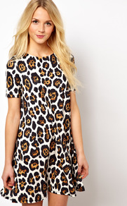 Swing Dress With Short Sleeve In Oversized Animal Print - style: t-shirt; neckline: round neck; fit: loose; secondary colour: tan; occasions: casual, evening, holiday; length: just above the knee; fibres: polyester/polyamide - stretch; predominant colour: multicoloured; sleeve length: short sleeve; sleeve style: standard; trends: statement prints; pattern type: fabric; pattern size: big & busy; pattern: animal print; texture group: jersey - stretchy/drapey