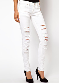 Ripped Skinny Jean - style: skinny leg; length: standard; pattern: plain; pocket detail: traditional 5 pocket; waist: mid/regular rise; predominant colour: white; occasions: casual; fibres: cotton - stretch; texture group: denim; pattern type: fabric; pattern size: small & light