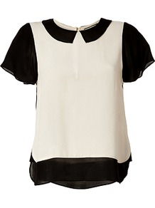 Nude/Black Loiva Top - style: blouse; shoulder detail: contrast pattern/fabric at shoulder; secondary colour: nude; predominant colour: black; occasions: casual, evening, work; length: standard; fibres: viscose/rayon - 100%; fit: straight cut; neckline: no opening/shirt collar/peter pan; back detail: longer hem at back than at front; sleeve length: short sleeve; sleeve style: standard; texture group: sheer fabrics/chiffon/organza etc.; pattern type: fabric; pattern size: small &amp; light; pattern: colourblock