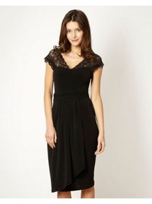 Designer Black Lace Shoulder Dress - style: shift; length: below the knee; neckline: low v-neck; sleeve style: capped; fit: tailored/fitted; pattern: plain; back detail: low cut/open back; waist detail: twist front waist detail/nipped in at waist on one side/soft pleats/draping/ruching/gathering waist detail; shoulder detail: contrast pattern/fabric at shoulder; predominant colour: black; occasions: evening, occasion; fibres: polyester/polyamide - stretch; hip detail: soft pleats at hip/draping at hip/flared at hip; sleeve length: short sleeve; texture group: jersey - clingy; pattern type: fabric; embellishment: lace