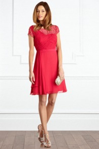 Silvana Dress - neckline: round neck; sleeve style: capped; pattern: plain; shoulder detail: contrast pattern/fabric at shoulder; bust detail: ruching/gathering/draping/layers/pintuck pleats at bust; predominant colour: hot pink; occasions: evening, occasion; length: just above the knee; fit: fitted at waist &amp; bust; style: fit &amp; flare; fibres: polyester/polyamide - 100%; hip detail: soft pleats at hip/draping at hip/flared at hip; sleeve length: sleeveless; texture group: sheer fabrics/chiffon/organza etc.; trends: volume; pattern type: fabric; embellishment: lace