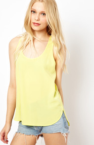 Sporty Vest - pattern: plain; sleeve style: sleeveless; style: vest top; predominant colour: primrose yellow; occasions: casual, holiday; length: standard; neckline: scoop; fibres: polyester/polyamide - 100%; fit: loose; shoulder detail: added shoulder detail; back detail: longer hem at back than at front; sleeve length: sleeveless; texture group: sheer fabrics/chiffon/organza etc.; pattern type: fabric