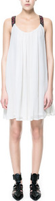 Flowing Dress With Embellished Straps - style: smock; sleeve style: standard vest straps/shoulder straps; fit: loose; back detail: racer back/sports back; predominant colour: white; occasions: casual, evening, occasion; length: just above the knee; neckline: scoop; fibres: polyester/polyamide - 100%; hip detail: soft pleats at hip/draping at hip/flared at hip; shoulder detail: added shoulder detail; sleeve length: sleeveless; texture group: sheer fabrics/chiffon/organza etc.; pattern type: fabric; pattern size: small &amp; light; embellishment: beading