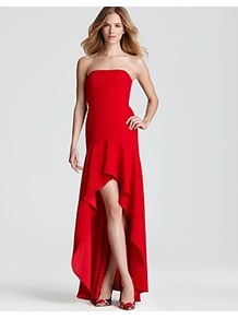 Strapless Dress High Low - length: mid thigh; neckline: strapless (straight/sweetheart); fit: tailored/fitted; pattern: plain; sleeve style: strapless; waist detail: fitted waist; predominant colour: true red; occasions: evening, occasion; style: asymmetric (hem); fibres: polyester/polyamide - 100%; hip detail: soft pleats at hip/draping at hip/flared at hip; back detail: longer hem at back than at front; sleeve length: sleeveless; texture group: crepes; pattern type: fabric