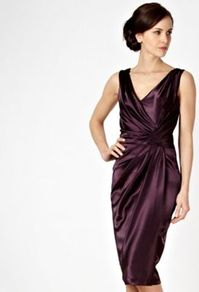 Dark Purple Asymmetric Tucked Satin Party Dress - style: faux wrap/wrap; neckline: v-neck; pattern: plain; sleeve style: sleeveless; waist detail: twist front waist detail/nipped in at waist on one side/soft pleats/draping/ruching/gathering waist detail; predominant colour: purple; occasions: evening, occasion; length: on the knee; fit: fitted at waist & bust; fibres: polyester/polyamide - stretch; hip detail: soft pleats at hip/draping at hip/flared at hip; sleeve length: sleeveless; texture group: structured shiny - satin/tafetta/silk etc.; bust detail: tiers/frills/bulky drapes/pleats; pattern type: fabric; pattern size: standard