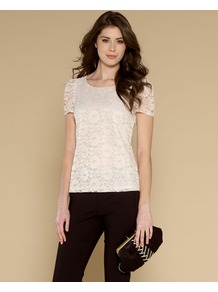 Lottie Lace Top - neckline: round neck; pattern: plain; predominant colour: ivory; occasions: evening, work, occasion; length: standard; style: top; fibres: polyester/polyamide - mix; fit: body skimming; shoulder detail: flat/draping pleats/ruching/gathering at shoulder; back detail: embellishment at back; sleeve length: short sleeve; sleeve style: standard; texture group: lace; pattern type: fabric