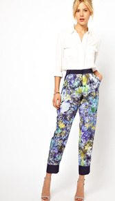 Trousers In Soft Floral Print - pocket detail: large back pockets, pockets at the sides; waist detail: wide waistband/cummerbund; waist: high rise; secondary colour: black; occasions: evening, work, holiday; length: ankle length; fibres: polyester/polyamide - 100%; hip detail: added detail/embellishment at hip; jeans &amp; bottoms detail: turn ups; predominant colour: multicoloured; texture group: silky - light; trends: high impact florals; fit: straight leg; pattern type: fabric; pattern size: big &amp; busy; pattern: florals; style: standard