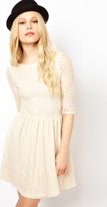 Lace Skater Dress - length: mid thigh; neckline: round neck; pattern: plain; waist detail: fitted waist; predominant colour: ivory; occasions: evening, occasion, holiday; fit: fitted at waist &amp; bust; style: fit &amp; flare; hip detail: ruching/gathering at hip; sleeve length: 3/4 length; sleeve style: standard; texture group: lace; pattern type: fabric; fibres: nylon - stretch; embellishment: lace