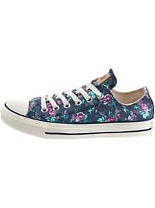 Chuck Taylor All Star Ox Floral Print Plimsolls - predominant colour: navy; occasions: casual, holiday; material: fabric; heel height: flat; toe: round toe; style: trainers; trends: high impact florals; finish: plain; pattern: florals