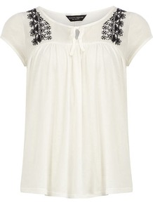 Ivory Peasant Top - pattern: plain; predominant colour: ivory; secondary colour: black; occasions: casual; length: standard; neckline: peep hole neckline; fibres: cotton - 100%; fit: loose; style: gypsy/peasant; shoulder detail: added shoulder detail; sleeve length: short sleeve; sleeve style: standard; texture group: cotton feel fabrics; bust detail: tiers/frills/bulky drapes/pleats; pattern type: fabric; embellishment: embroidered