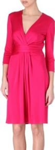 Ruched Silk Jersey Dress - style: faux wrap/wrap; neckline: low v-neck; pattern: plain; waist detail: fitted waist; bust detail: ruching/gathering/draping/layers/pintuck pleats at bust; predominant colour: hot pink; occasions: evening, occasion; length: on the knee; fit: fitted at waist & bust; fibres: silk - 100%; sleeve length: 3/4 length; sleeve style: standard; pattern type: fabric; pattern size: standard; texture group: other - light to midweight