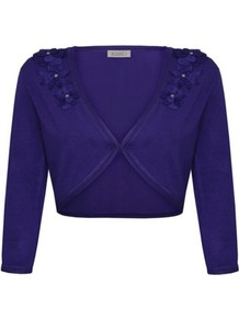 3/4 Sleeve Flower Bolero - pattern: plain; style: bolero/shrug; length: cropped; fit: slim fit; predominant colour: purple; occasions: evening, work, occasion; fibres: polyester/polyamide - 100%; shoulder detail: added shoulder detail; sleeve length: 3/4 length; sleeve style: standard; texture group: knits/crochet; collar break: medium; pattern type: knitted - fine stitch; pattern size: standard; embellishment: corsage