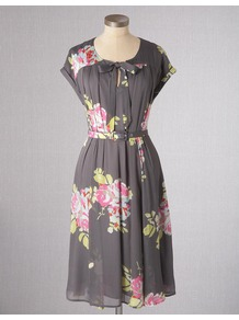 Bow Front Dress - style: tea dress; neckline: round neck; sleeve style: capped; fit: fitted at waist; bust detail: added detail/embellishment at bust; waist detail: belted waist/tie at waist/drawstring; predominant colour: charcoal; occasions: casual, evening, work, holiday; length: on the knee; fibres: viscose/rayon - 100%; hip detail: structured pleats at hip; sleeve length: short sleeve; texture group: sheer fabrics/chiffon/organza etc.; trends: high impact florals; pattern type: fabric; pattern size: big &amp; busy; pattern: florals