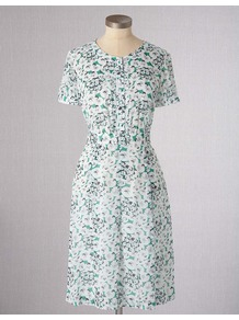 Summer Tea Dress - style: tea dress; neckline: round neck; sleeve style: puffed; fit: fitted at waist; bust detail: buttons at bust (in middle at breastbone)/zip detail at bust; predominant colour: white; occasions: casual; length: on the knee; fibres: viscose/rayon - 100%; sleeve length: short sleeve; trends: statement prints; pattern type: fabric; pattern size: standard; pattern: patterned/print; texture group: woven light midweight