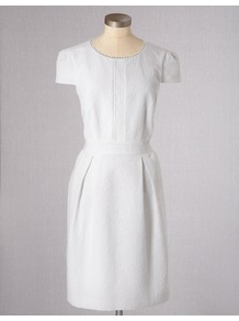 Clara Dress - style: shift; neckline: round neck; sleeve style: capped; fit: tailored/fitted; pattern: plain; bust detail: added detail/embellishment at bust; predominant colour: white; occasions: casual; length: just above the knee; fibres: cotton - mix; hip detail: sculpting darts/pleats/seams at hip; sleeve length: sleeveless; texture group: ornate wovens; pattern type: fabric; pattern size: standard; embellishment: embroidered