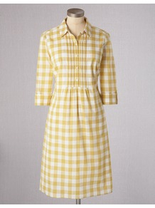 Gingham Shirt Dress - style: shirt; neckline: shirt collar/peter pan/zip with opening; fit: tailored/fitted; pattern: checked/gingham; waist detail: fitted waist; bust detail: ruching/gathering/draping/layers/pintuck pleats at bust; secondary colour: white; predominant colour: primrose yellow; occasions: casual, work; length: just above the knee; fibres: cotton - 100%; sleeve length: 3/4 length; sleeve style: standard; texture group: cotton feel fabrics; pattern type: fabric; pattern size: small &amp; busy